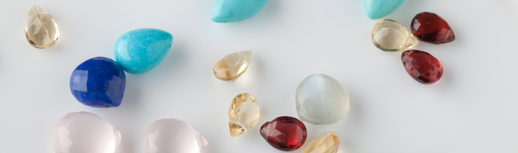 Sophie Lutz banner showing many different gem stones
